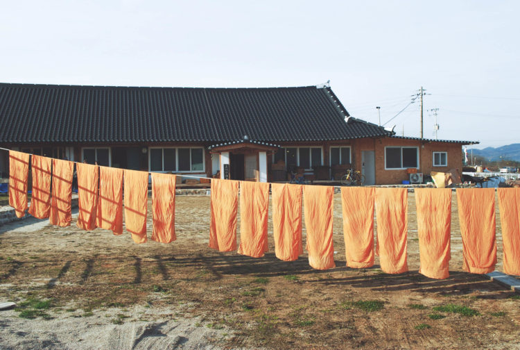 drying dyed scarves hanbol, namwon, korea