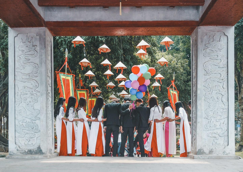 Graduates posing at Temple of Literature in Hanoi