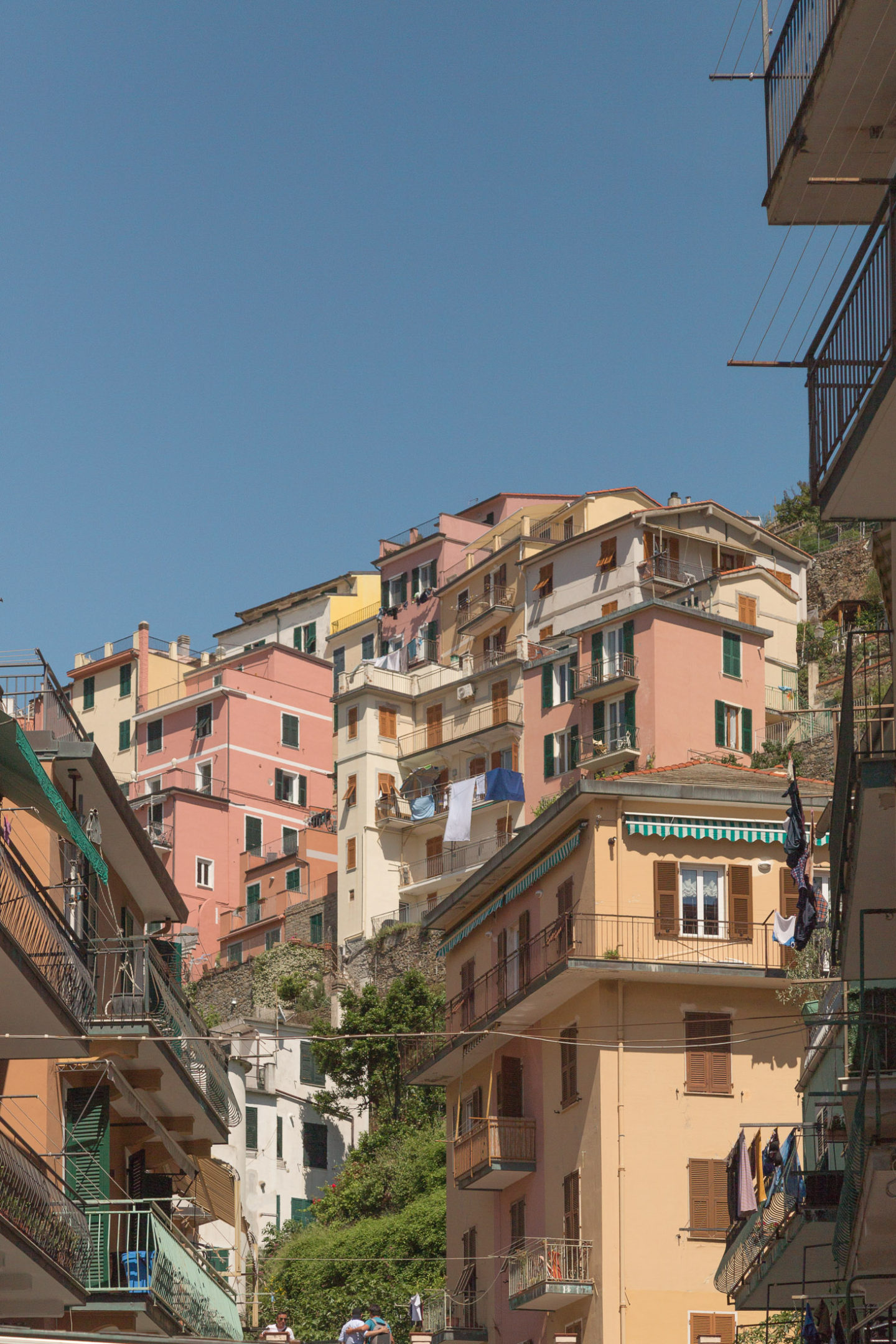 angled up view of pastel colored buildings