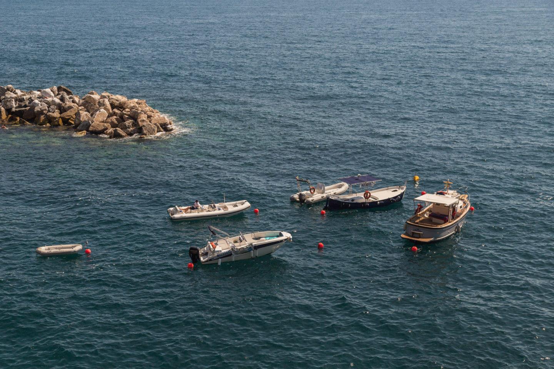 five boats in dark blue water
