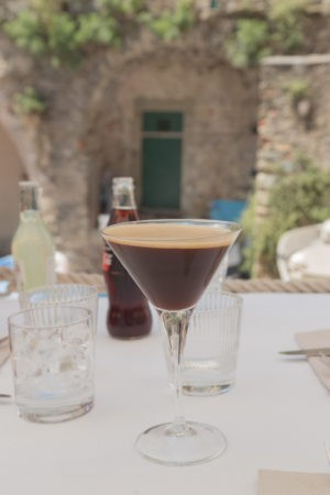 Caffe Shakerato - a black iced coffee in a V-shaped wine glass