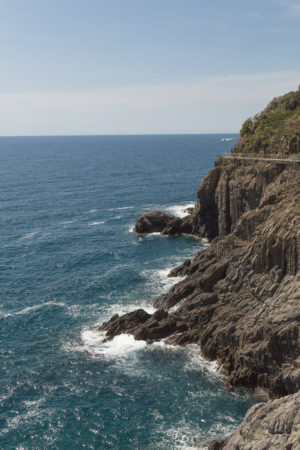cliffside to the right overlooking a blue sea