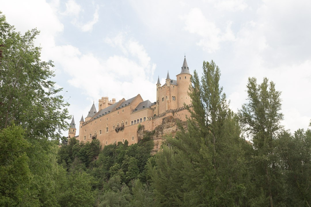 Sandy colored alcazar of Segovia from below