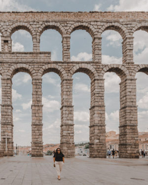 Girl standing in front of Aqueducts