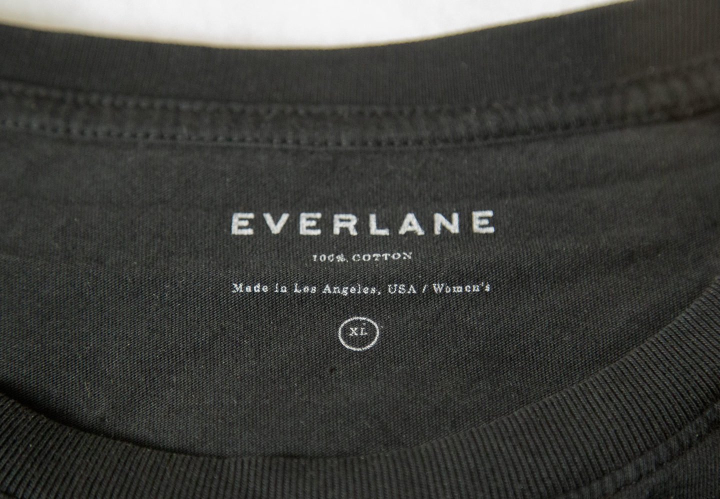 screenprinted everlane logo on black t shirt