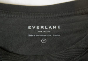 screenprinted everlane logo on black t shirt