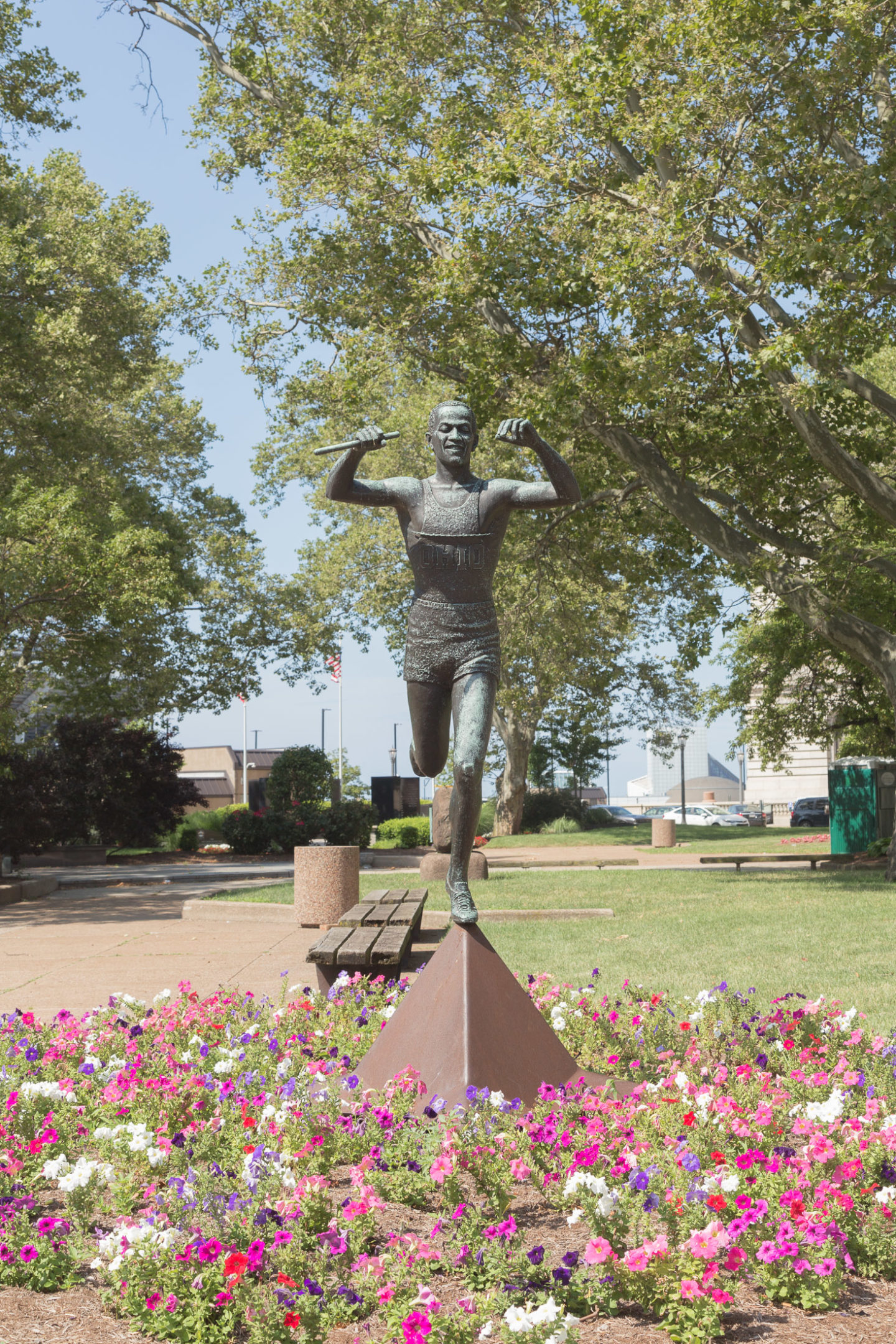 Jesse Owens Statue surrounded by flowers in Cleveland, Ohio