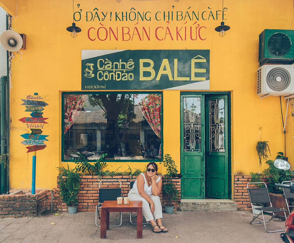 Outside a yellow-walled cafe in Con Dao, an island in southern Vietnam with my favorite Vietnamese drinks -- coconut coffee!